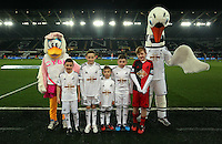 SWANSEA, WALES - MARCH 16: Children mascots<br />