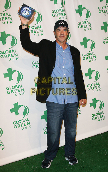 Wyland.Global Green USA's 9th Annual Pre-Oscar Party held at the Avalon, Hollywood, California, USA..February 22nd, 2012.full length black suit jacket blue shirt jeans denim arm in air baseball cap hat.CAP/ADM.©AdMedia/Capital Pictures.