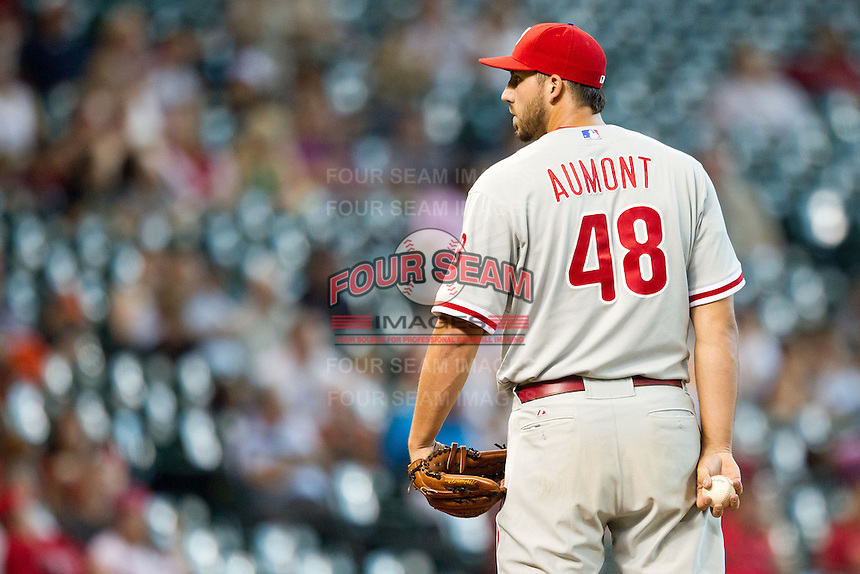 Philadelphia Phillies pitcher Phillippe Aumont #48 looks in for the sign during the Major League baseball game against the Houston Astros on September 16th, 2012 at Minute Maid Park in Houston, Texas. The Astros defeated the Phillies 7-6. (Andrew Woolley/Four Seam Images).