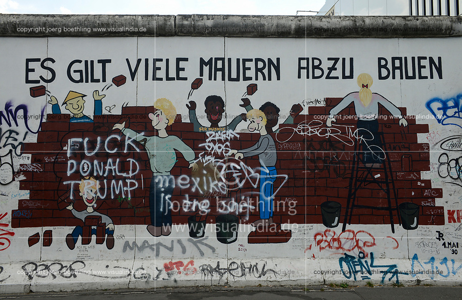 Germany, Berlin, The wall, East side gallery, wall paintíngs and murals about the cold war and walls, written: There are many walls to tear down and Fuck Donald Trump ! Mexiko is the shit