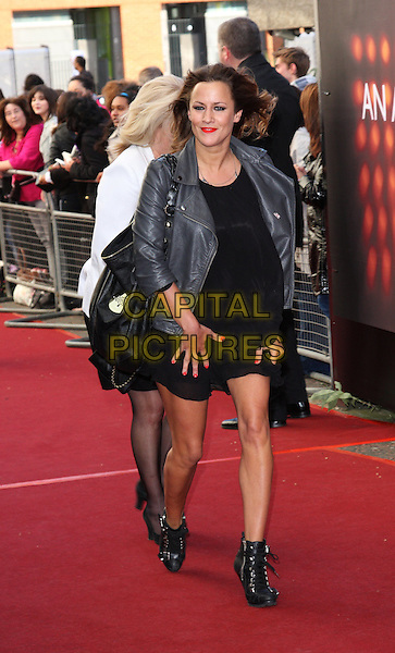 CAROLINE FLACK.'An Audience with Michael Buble' Red Carpet arrivals at the London ITV Studios, South Bank, London, England. .May 3rd 2010 .full length black dress grey gray leather jacket booties ankle boots bag purse pregnant windy.CAP/ROS.©Steve Ross/Capital Pictures.