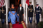 United States President Barack Obama and first lady Michelle Obama walk out to welcome President Francois Hollande of France on the North Portico of the White House before the State Dinner in Hollande's honor in Washington, District of Columbia, U.S., on Tuesday, Feb. 11, 2014.  After an arrival ceremony on the South Lawn, Obama and Hollande met in the Oval Office for a policy meeting then gave a joint press conference in the East Room of the White House. <br /> Credit: Pete Marovich / Pool via CNP