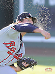 Photo of the Rome Braves in a game against the Greenville Drive on Wednesday, August 21, 2013, at Fluor Field at the West End in Greenville, South Carolina. (Tom Priddy/Four Seam Images)