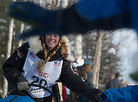 Kristy Berington greets fans as she leaves Willow Lake during the Iditarod restart. (Stephen Nowers photo).
