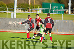 Action from the AC Athletic v Killarney Celtic game in Mounthawk Park on Sunday last as AC Athletic's David Egan, Robert Silles and Mark Walsh close down Killarneys Conor McCarthy attack.