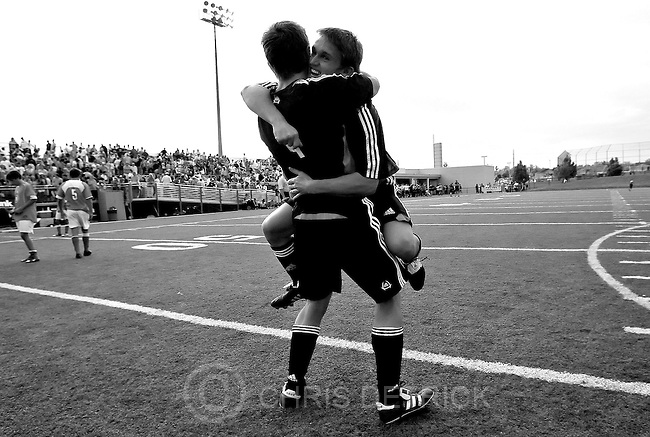Draper, UT--5/26/06--.Alta's Travis Price leaps into the arms of Collin Halliday after defeating Bountiful, 1-0, in the 5A State High School Soccer State Championships.<br />