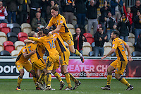 Rhys Healey of Newport County (obscured) is mobbed after scoring his side's second goal during the Sky Bet League 2 match between Newport County and Carlisle United at Rodney Parade, Newport, Wales on 12 November 2016. Photo by Mark  Hawkins.