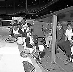 Pittsburgh PA:  Pirate players, Willie Stargell #8 and Manny Mota #15 in the dugout at the HYPO charity baseball game with the Cleveland Indians - 1964.The money raised by HYPO (Help Young Players Organize) was used to help local communities buy equipment and build ball fields.
