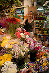Reading Terminal Market, woman buying flowers, mod rel..Philadelphia, Pennsylvania, PA USA.  Photo copyright Lee Foster, 510-549-2202, lee@fostertravel.com, www.fostertravel.com.  Photo 224-30299