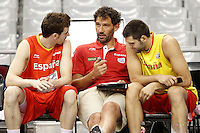 Spain's Victor Claver (l) and Felipe Reyes (r) with the ex player Jorge Garbajosa (c) now member of the technical corp in the national basket team during training session.July 24,2012(ALTERPHOTOS/Acero) /NortePhoto.com.<br />