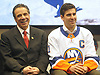 New York State Governor Andrew Cuomo, left, smiles alongside New York Islanders captain John Tavares during a news conference at Nassau Coliseum on Monday, Jan. 29, 2018. Cuomo announced the site will host a portion of Islanders home games over the next three seasons as the team's new arena at Belmont is being constructed.