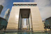 Dubai Financial District.  The Gate Building housing the DIFC, the international finance centre.  Emirates Towers and World Trade Centre visible through arch..