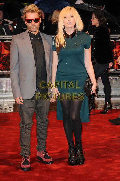"THE TING TINGS - Jules de Martino & Katie White .Attending the ""Red"" UK film premiere, .Royal Festival Hall, Southbank Centre, .London, England, UK, .19th October 2010..full length band group green dress collar black tights grey gray jacket sunglasses peep toe ankle boots platform trainers shirt clutch bag jeans .CAP/CAS.©Bob Cass/Capital Pictures."