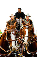 Charlotte Mayor Anthony Foxx caught a ride in on the Wells Fargo Stagecoach to kick off the Wells Fargo Community Celebration..Thousands of Charlotteans and visitors flocked to downtown Charlotte on Saturday, October 29, 2011, for the Wells Fargo Community Celebration. The daylong festival took place in the streets, in public atriums and in downtown museums, which offered free admission all day long. Wells Fargo, which this month completed its conversion from Wachovia, picked up the bill.