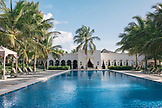 ZANZIBAR, Paje Beach, View of the Swimming Pool and a building at the Baraza Hotel