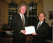 United States President Bill Clinton receives the credentials of the newly appointed Ambassador to Vietnam, H.E. Le Van Bang in the Oval Office of the White House in Washington, DC on May 14, 1997.<br /> Credit:  White House via CNP