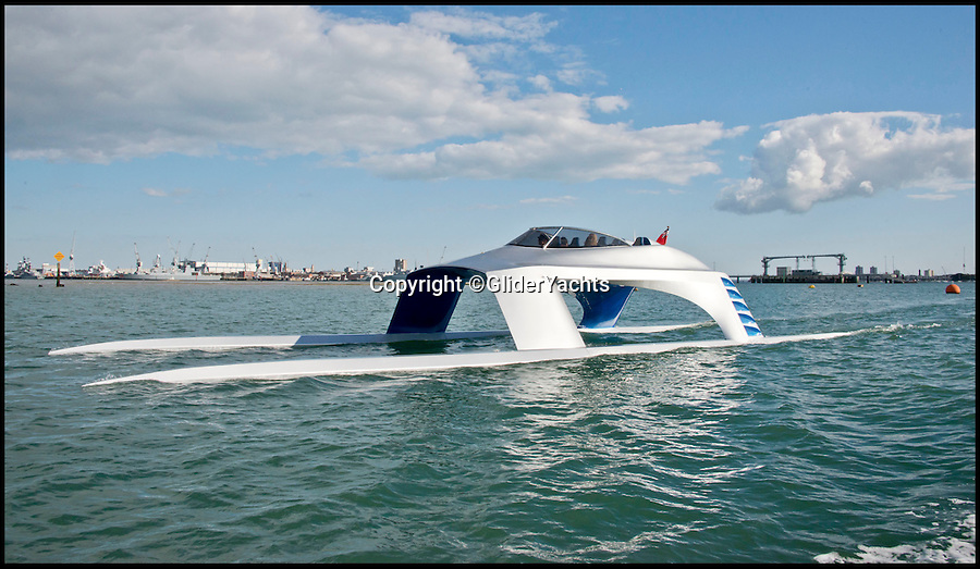BNPS.co.uk (01202 558833)<br /> Pic: GliderYachts/BNPS<br /> <br /> This futuristic superyacht might look like something out of a James Bond film but it could be coming to a harbour near you very soon.<br /> <br /> These are the first official pictures of the new 60ft stylish Glider SS18, the first boat of its kind.<br /> <br /> It has been hailed a 'game-changer' in the yachting world and its creators say it will revolutionise sea travel for the rich and famous.<br /> <br /> At about £1million a pop, top-of-the-range transport doesn't come cheap. But for those who can afford it the dramatic power cat offers the ultimate luxury and comfort.