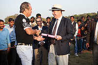 Dr Lachlan Strahan (right) presents a gift to Greg Johnson, the captain of the Western Australia Polo Team after a close match for the Argyle Pink Diamond Cup, organised as part of the 2013 Oz Fest in the Rajasthan Polo Club grounds in Jaipur, Rajasthan, India on 10th January 2013. Photo by Suzanne Lee