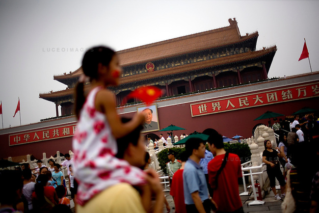 A portrait of Chairman Mao watches over tourists from the entrance of the Forbidden City in Beijing, China on Sunday, August 10, 2008.  Kevin German