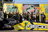 Aug. 4, 2013; Kent, WA, USA: NHRA top fuel dragster driver Morgan Lucas celebrates with crew after winning the Northwest Nationals at Pacific Raceways. Mandatory Credit: Mark J. Rebilas-USA TODAY Sports