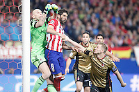 Atletico de Madrid´s Raul Garcia (C) and Milan´s goalkeeper Christian Abbiati (L) during 16th Champions League soccer match at Vicente Calderon stadium in Madrid, Spain. March 11, 2014. (ALTERPHOTOS/Victor Blanco)