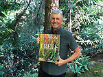 Art Wolfe holds his 2018 book TREES Between Earth and Heaven<br />