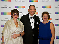 Valerie Jarrett, Neil Cohen, and Susan Sher arrive for the formal Artist's Dinner honoring the recipients of the 40th Annual Kennedy Center Honors hosted by United States Secretary of State Rex Tillerson at the US Department of State in Washington, D.C. on Saturday, December 2, 2017. The 2017 honorees are: American dancer and choreographer Carmen de Lavallade; Cuban American singer-songwriter and actress Gloria Estefan; American hip hop artist and entertainment icon LL COOL J; American television writer and producer Norman Lear; and American musician and record producer Lionel Richie. Photo Credit: Ron Sachs/CNP/AdMedia