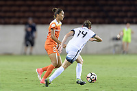 Houston, TX - Saturday July 08, 2017: Poliana Barbosa Medeiros attempts to pass the ball away from Ashleigh Sykes during a regular season National Women's Soccer League (NWSL) match between the Houston Dash and the Portland Thorns FC at BBVA Compass Stadium.
