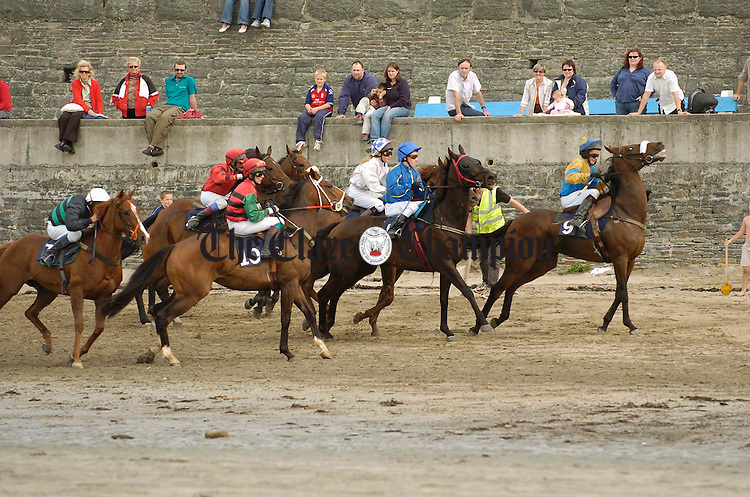 Straing at the reins, the horses set off at the start line during the Strand races in Kilkee. Photograph by John Kelly.