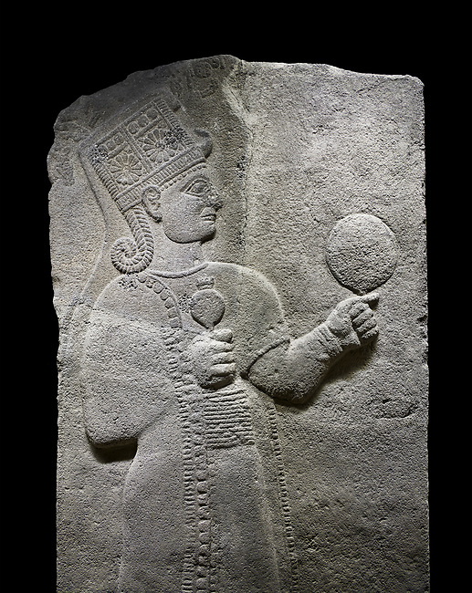 Hittite relief sculpted orthostat stone panel of Long Wall Basalt, Karkamıs, (Kargamıs), Carchemish (Karkemish), 900 - 700 B.C. Anatolian Civilizations Museum, Ankara, Turkey.<br /> <br /> Goddess Kubaba. Goddess is depicted from the profile. The part below the chest of the relief is broken. She holds a pomegranate in her hands on her chest. She carries a one-horned headdress on her head. Her braided hair hangs down to her shoulder. The text in the hieroglyphics is not understood. The lower part of the relief has been restored. <br /> <br /> On a black background.