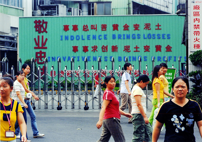 "A sign reads ""indolence brings losses"" outside a factory at the Yuen Yue shoe factory complex where 100,000 workers make shoes in Gao Bu Town, Guangdong, China. The complex makes shoes for shoemakers Puma, Adidas and Nike amongst others..06 Sep 2006"