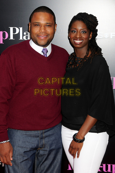 "ANTHONY ANDERSON & ALVINA STEWART.""The Back-up Plan"" Los Angeles Premiere held at the Regency Village Theatre, Westwood, California, USA,.21st April 2010..arrivals half length married couple husband wife red maroon jumper sweater tie black top purple .CAP/ADM/BP.©Byron Purvis/AdMedia/Capital Pictures."
