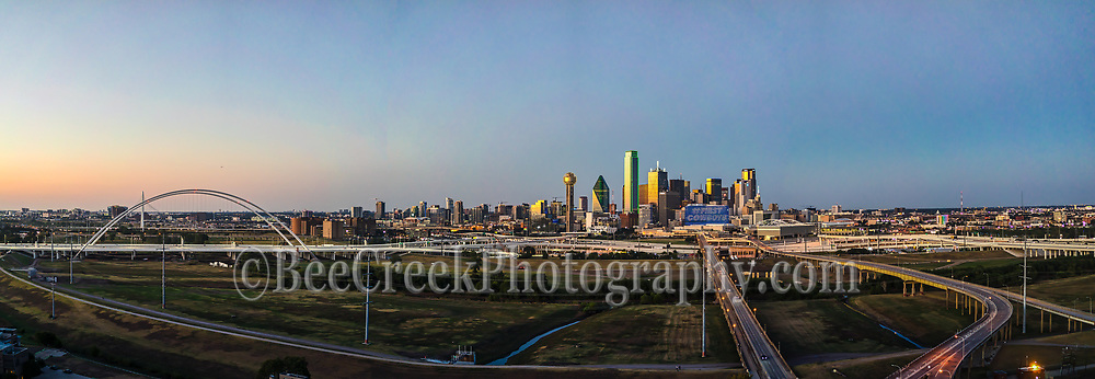 Another Dallas Aerial cityscape view from south location of the city with the new Margaret McDermott Bridge at twillight panorama.  The sun was just going down when the sky lit up with some the pinks and blues of the twillight or blue hour as some called it along the Trinity river.  The high rise building still had a hint of light from the sunset and you can see the freeway around the area into downtown.