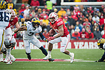 Wisconsin Badgers running back Jonathan Taylor (23) carries the ball during an NCAA College Big Ten Conference football game against the Michigan Wolverines Saturday, November 18, 2017, in Madison, Wis. The Badgers won 24-10. (Photo by David Stluka)