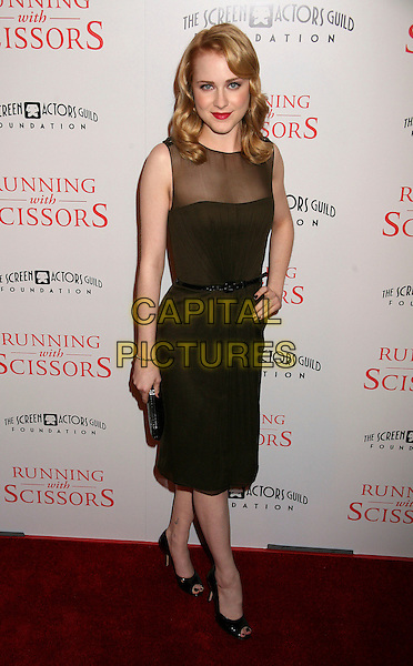 "EVAN RACHEL WOOD.World Premiere of ""Running With Scissors"", Beverly Hills, California, USA..October 10th, 2006.Ref: ADM/BP.full length dress black hand on hip sheer sleeveless brown belt.www.capitalpictures.com.sales@capitalpictures.com.©Byron Purvis/AdMedia/Capital Pictures."