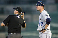 West Michigan Whitecaps Manager Andrew Graham (17) is ejected by umpire Ryan Wilhelms in the 8th inning of the game against the Fort Wayne TinCaps on May 23, 2016 at Parkview Field in Fort Wayne, Indiana. The TinCaps defeated the Whitecaps 3-0. (Andrew Woolley/Four Seam Images)