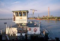 """- pusher of """"Fluviopadana"""" company with barges in navigation on the Po river near the Sermide electric power plant....- spintore della compagnia """"Fluviopadana"""" e chiatte in navigazione sul fiume Po in vista della centrale elettrica di Sermide"""