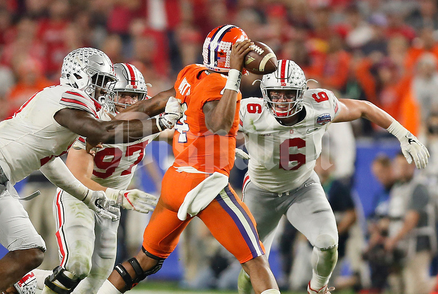 Clemson Tigers quarterback Deshaun Watson (4) gets pressured by Ohio State Buckeyes defensive end Jalyn Holmes (11), defensive end Nick Bosa (97) and defensive end Sam Hubbard (6) during the third quarter of the College Football Playoff semifinal Fiesta Bowl at University of Phoenix Stadium in Glendale, Arizona on Dec. 31, 2016. (Adam Cairns / The Columbus Dispatch)