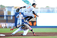 Wisconsin Timber Rattlers shortstop Orlando Arcia #2 throws to first as Roberto Pena #10 slides in during a game against the Quad Cities River Bandits on May 24, 2013 at Modern Woodmen Park in Davenport, Iowa.  Quad Cities defeated Wisconsin 4-3  (Mike Janes/Four Seam Images)