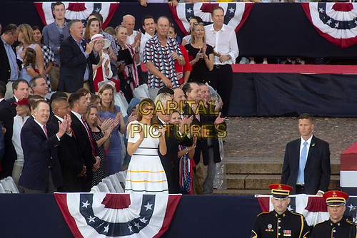 First Lady Melania Trump watches as United States President Donald J. Trump delivers remarks at his Salute to America event in Washington D.C. on July 4, 2019.  The event has been criticized as politicizing a traditionally non-political holiday.<br /> CAP/MPI/CNP<br /> ©CNP/MPI/Capital Pictures