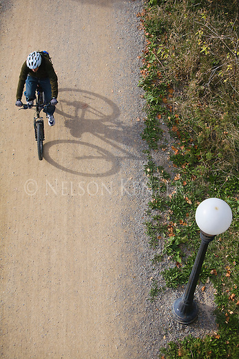Bicycler on the Riverfront Trails along the Clark Fork River in Missoula, Montana