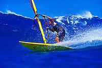 Windsurfing a large blue wave at world famous Hookipa Beach Park on Maui.