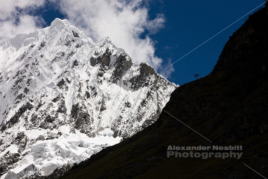 The peak of Navado Alpamayo in Peru, famous for its nearly perfect triangular peak