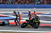 8th September 2017, Misano World Circuit, Misano Adriatico, San Marino; San Marino MotoGP, Friday free practice; Johann Zarco (Monster Yamaha Tech 3) goes past the crashed bike of  Andrea Iannone (Suzuki ecstar) during the free practice sessions