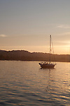 Sailboat at sunset in summer on Lake Michigan in Traverse City, Michigan, MI, USA