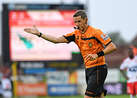 KORTRIJK , BELGIUM - AUGUST 03 : referee Jan Boterberg pictured pointing towards the penaltyspot and giving a penaltykick in favour of Charleroi after consulting the VAR during the Jupiler Pro League match day 2 between Kv Kortrijk and Sporting Charleroi on August 03 , 2019 in Kortrijk , Belgium . ( Photo by David Catry / Isosport )