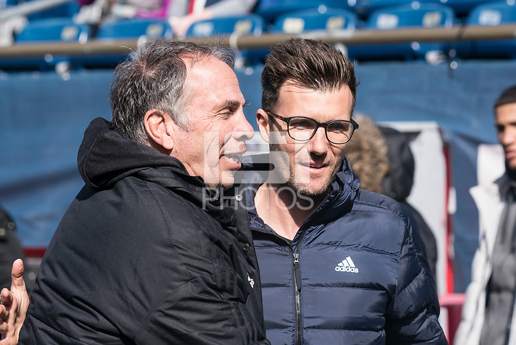 FOXBOROUGH, MA - MARCH 7: New England coach Bruce Arena and Chicago coach Raphael Wicky greet before the game during a game between Chicago Fire and New England Revolution at Gillette Stadium on March 7, 2020 in Foxborough, Massachusetts.