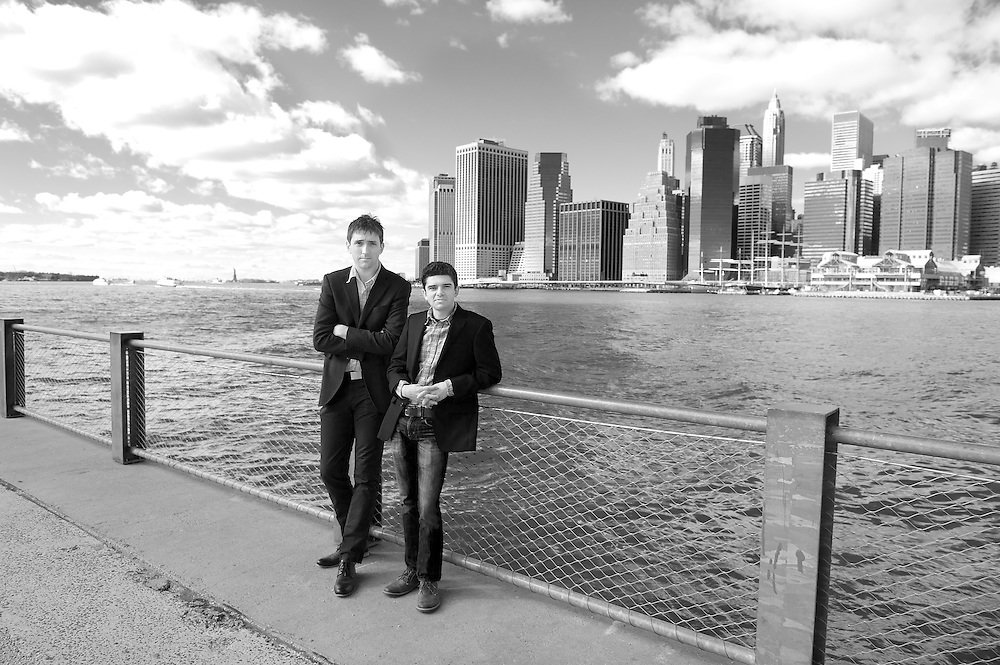 Black & white portrait of two business partners photographed on the Brooklyn waterfront.