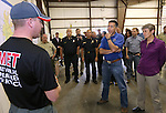 Incident Meteorologist Alex Hoon, left, and other fire officials brief Nevada Gov. Brian Sandoval, center, and Secretary of the Interior Sally Jewell, right, on the Washington fire at a command post in Gardnerville, Nev., on Wednesday, June 24, 2015. The lightning-caused fire near Markleeville, Ca. has grown to nearly 17,000 acres since Friday.<br /> Photo by Cathleen Allison