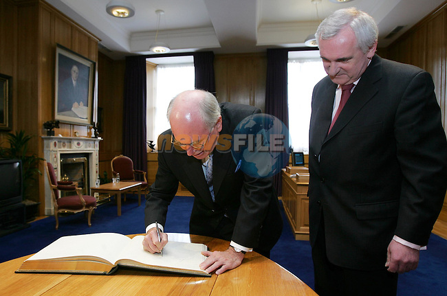Dublin Ireland..Australian PM John Howard meetingsigning the visitors book with Irish Taoiseach (Prime Minister) Bertie Ahern, at Government buildings in Dublin 22/5/06 PM Howard is on a four day visit to Ireland..Photo AFP/NEWSFILE/FRAN CAFFREY..(Photo credit should read AFP PHOTO/FRAN CAFFREY/NEWSFILE)...This Picture has been sent you under the condtions enclosed by:.Newsfile Ltd..the Studio,.Millmount Abbey,.Drogheda,.Co Meath..Ireland..Tel: +353(0)41-9871240.Fax: +353(0)41-9871260.GSM: +353(0)86-2500958.email: pictures@newsfile.ie.www.newsfile.ie.FTP: 193.120.102.198..This picture is from Fran Caffrey@newsfile.ie